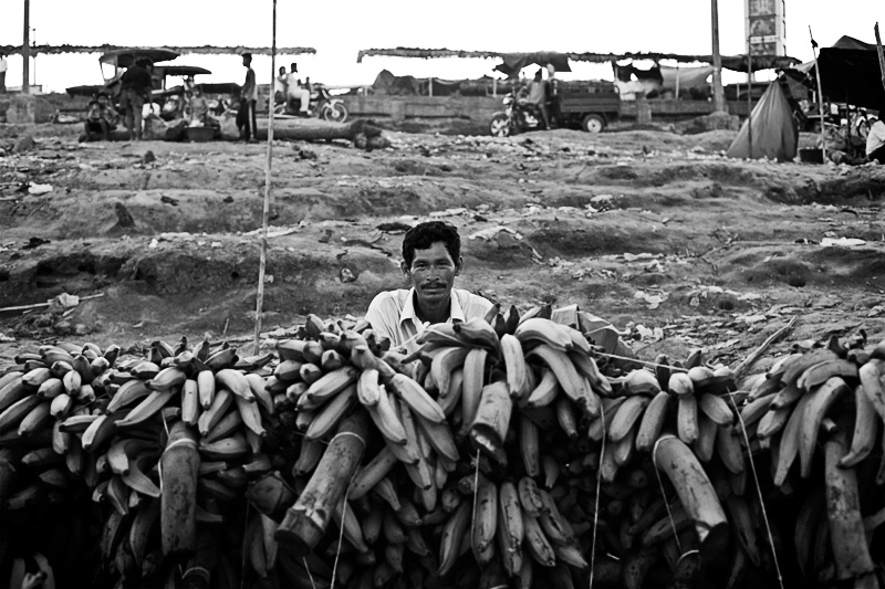 man behind bananas, pucallpa, peru, amazonia